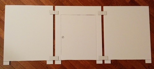 Materials used to build the cat litter box stall, white cardboard.